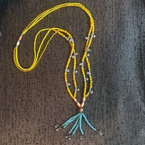 Bead necklace with bells.